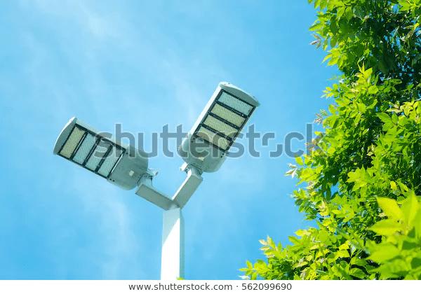 Led street light against blue sky