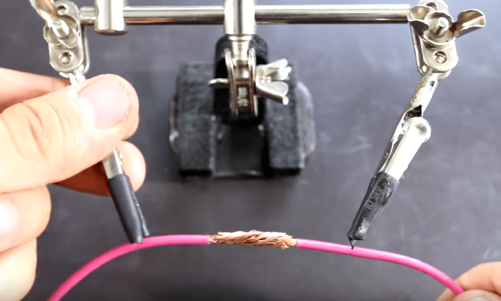 Using a helping hand to clamp wire before soldering