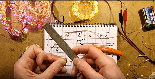 scraping lacquer off of broken copper wire