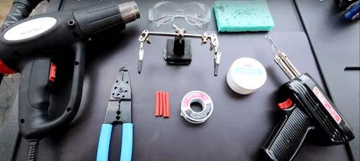 tools for repairing wires on solar lights, heat gun, safety glass, wire cutter, solder